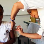 In Sao Paulo, Brazil, a young girl receives the HVP cervical cancer vaccine, given at public and private schools throughout the county and in the 36,000 vaccination centers of the national health system (March 2014). Photo: PAHO/WHO