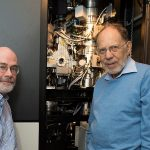 Michael Rossmann (right), Purdue University's Hanley Distinguished Professor of Biological Sciences, and Richard Kuhn, director of the Purdue Institute for Inflammation, Immunology and Infectious Diseases, stand with the cryo-electron microscope used to determine the structure of the Zika virus. (Purdue University photo/Mark Simons)